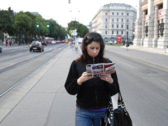 Reading a map on the streets of Vienna.  Today, I would check the map on my iPhone so it looks like I'm just reading text messages